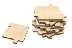 Wooden puzzle. On a white background Royalty Free Stock Photo