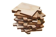 Wooden puzzle. On a pile Royalty Free Stock Images