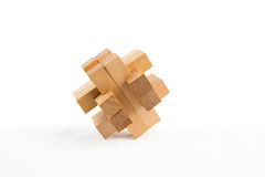 Wooden puzzle. Wooden  puzzle. Isolated on white background Royalty Free Stock Photos