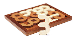 Wooden puzzle. Wooden 3D puzzle collection hobby Stock Photo