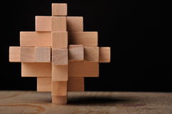 Wooden puzzle. Wooden 3-d Puzzle for children or adults Stock Photo