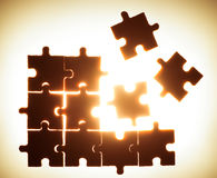 Wooden puzzle and backlight background Stock Images