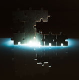 Wooden puzzle and backlight background. Close up Royalty Free Stock Images