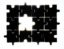 Wooden puzzle and backlight background Royalty Free Stock Photos