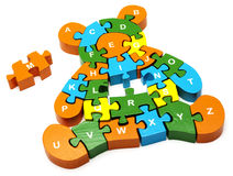Wooden puzzle  bear. Wooden colored puzzle in bear form with letters Stock Photos