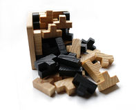 Wooden puzzle blocks on white background. With shadow Stock Photos