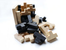 Wooden puzzle blocks on white background. With shadow Royalty Free Stock Photography