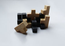Wooden puzzle blocks on white background. With shadow Royalty Free Stock Photos