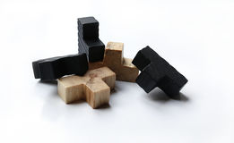 Wooden puzzle blocks on white background. With shadow Stock Photo