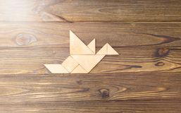 Wooden puzzle in the form of a bird stock photo
