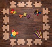 Wooden puzzle frame early learning royalty free stock photo