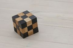 Wooden puzzle on a light pine floor stock images