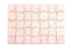 Wooden puzzle pattern on white background Royalty Free Stock Photo