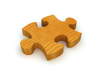 Wooden Puzzle Piece. A single wooden puzzle piece representing a natural solution or environmentally friendly solution Royalty Free Stock Photo