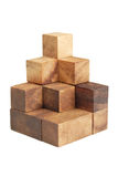 Wooden puzzle pyramid isolated Royalty Free Stock Photos