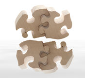 Wooden puzzle with reflection Stock Photos