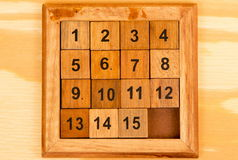 Wooden puzzle on the table Stock Photo