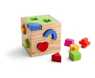 Wooden puzzle toy with colorful blocs isolated over white. Background royalty free stock photo