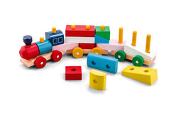 Wooden puzzle toy train with colorful blocs over white. Background royalty free stock photography