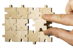 Wooden puzzle on white background. . Close up Stock Image
