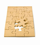 Wooden puzzles. With a winning side, on a white background Royalty Free Stock Photography