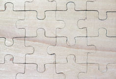 Wooden puzzles Stock Images