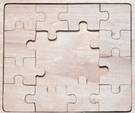 Wooden puzzles. Stock Images