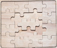 Wooden puzzles. Royalty Free Stock Image