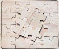Wooden puzzles. Royalty Free Stock Photography