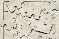 Wooden puzzles Stock Photos
