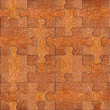 Wooden puzzles assembled for seamless background, Carpathian Elm Royalty Free Stock Photos