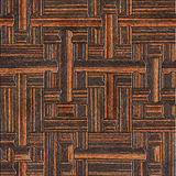 Wooden puzzles assembled for seamless background - Ebony wood. Texture Stock Photography