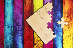 Wooden puzzles. On bright background Stock Images