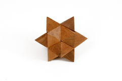 Wooden puzzles cast star-shaped. Isolated royalty free stock photography