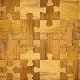 Wooden puzzles - seamless background - decorative pattern Royalty Free Stock Photos