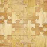 Wooden puzzles - seamless background. Decorative pattern Royalty Free Stock Photography