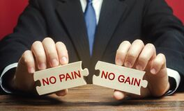 Free Wooden Puzzles With The Words No Pain, No Gain In The Hands Of A Man. Motivation, Aspiration, Goal Achievement Concept. Management Stock Photo - 175072680