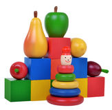 Wooden pyramid, fruits, cubes education kit Royalty Free Stock Photography
