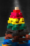 Wooden Pyramid - Toy with Colorful Pieces Stock Photo