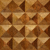 Wooden pyramids stacked for seamless background Stock Photo
