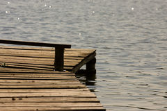 Wooden quay. Over a quiet blue lake Royalty Free Stock Images