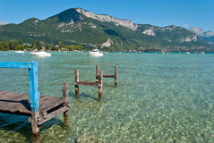 Wooden quay in Annecy lake, Savoy, France Royalty Free Stock Photo