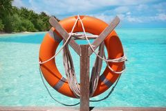 Wooden rack with flotation ring. At sea resort royalty free stock images