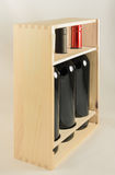 Wooden rack with three wine bottles. Little wooden rack with three different type of wine bottles for a present or a gift on a white background royalty free stock images