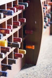 Wooden rack with wine bottles Royalty Free Stock Images