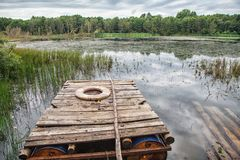 Wooden Raft On The Lake Royalty Free Stock Photography