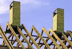 Wooden rafters on new house Stock Images