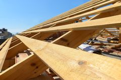 Wooden rafters on the roof. Of the house under construction royalty free stock photos