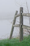Wooden Rail Fence on a Foggy Spring Morning Royalty Free Stock Images