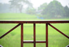 Wooden rail of hose terrace in raining. Relax time Stock Images